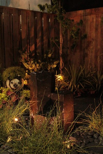 Canada Blooms garden with pondless water feature and lighting