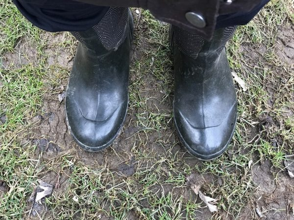 Boots on wet soil