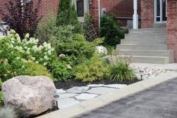 Low maintenance garden with rocks.